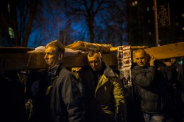 Euromaidan protesters carry the cross with Jesus Christ