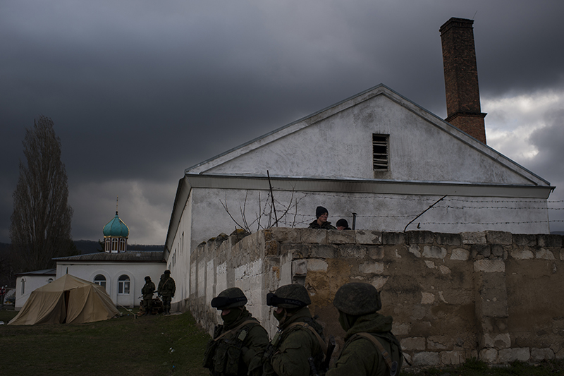 Ukrainian soldiers, surrounded by Russian troops, in one of military bases in Crimea